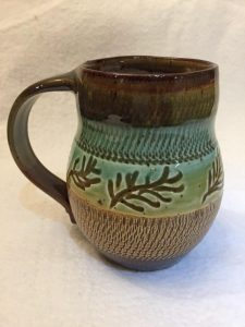 Pretty mug with tree branch design